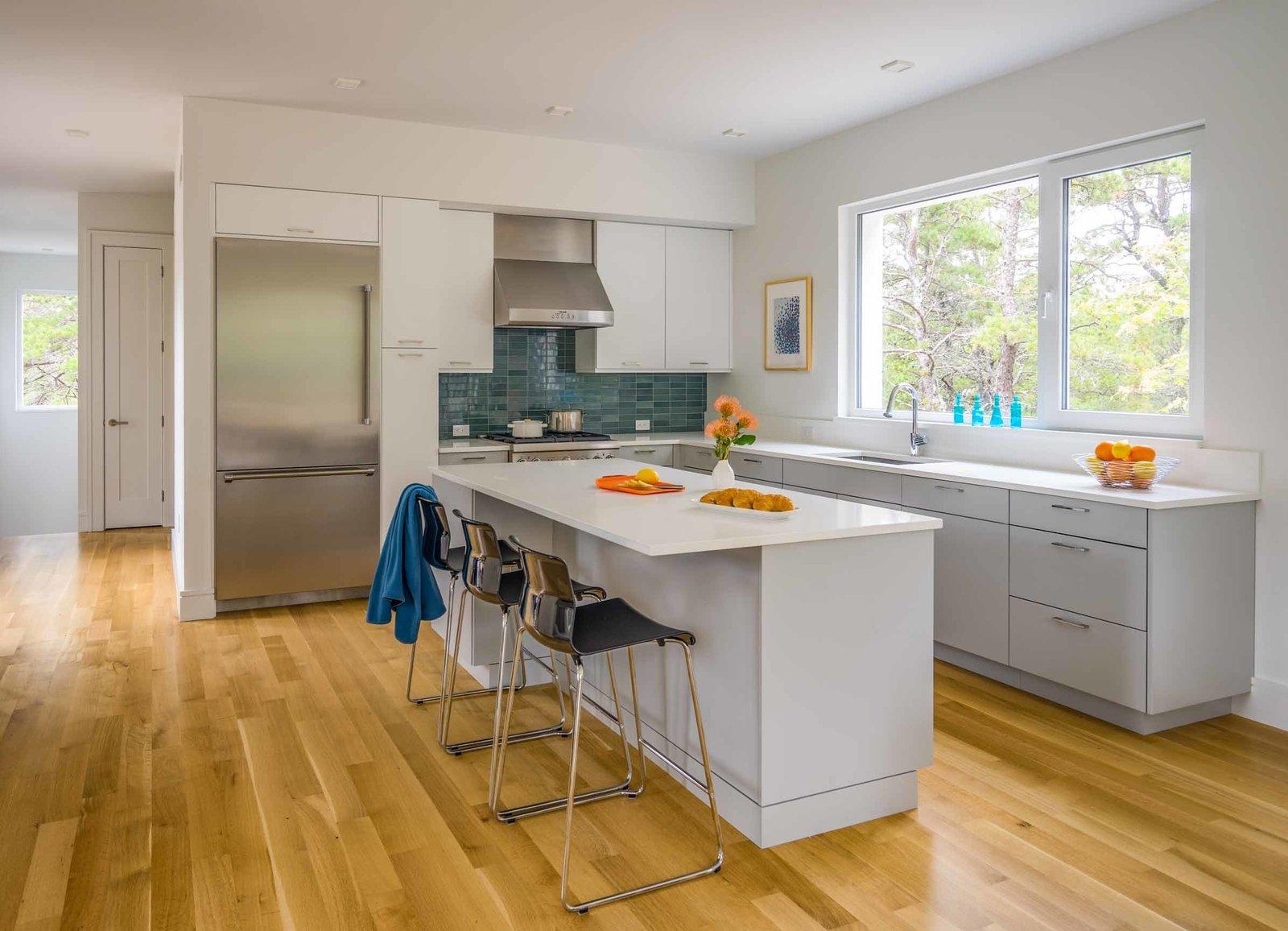 Kitchen, Refrigerator, Range, Medium Hardwood, Glass Tile, Ceiling, and Undermount  Best Kitchen Ceiling Glass Tile Photos from Wellfleet Modern