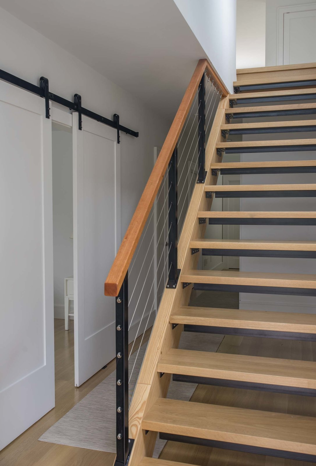 Staircase, Wood, Cable, Metal, and Wood  Staircase Wood Cable Metal Wood Photos from Wellfleet Modern