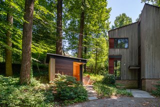 Treehouse Shed by Gardner Architects LLC is part of a masterplan that manages stormwater, creates a habitat for indigenous species, and embraces the neighboring trees—thereby preserving the quality of the community.
