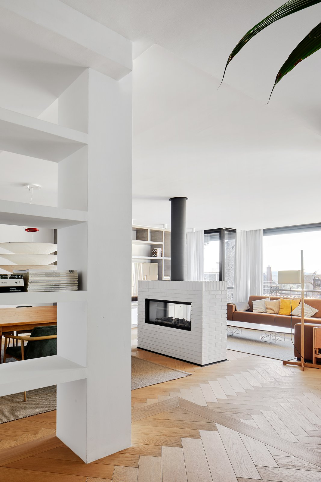 Living Room, Two-Sided Fireplace, and Light Hardwood Floor  Beautiful Duplex in Barcelona by CONTI, CERT