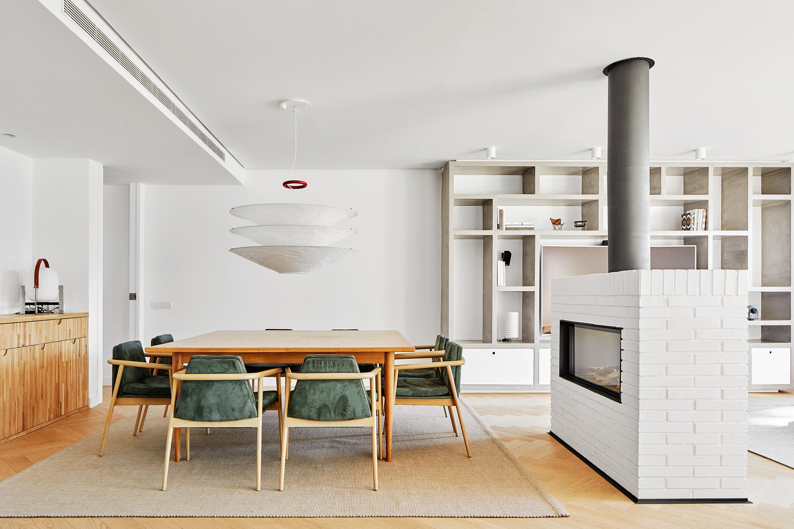 Dining Room, Light Hardwood Floor, Two-Sided Fireplace, and Table  Beautiful Duplex in Barcelona by CONTI, CERT