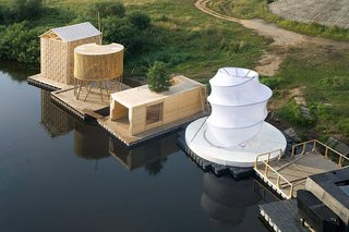 The firm's Kaluga Floating Sauna sits with other floating structures by Norman Foster, Francois Roche, Vladimir Plotkin, and others.