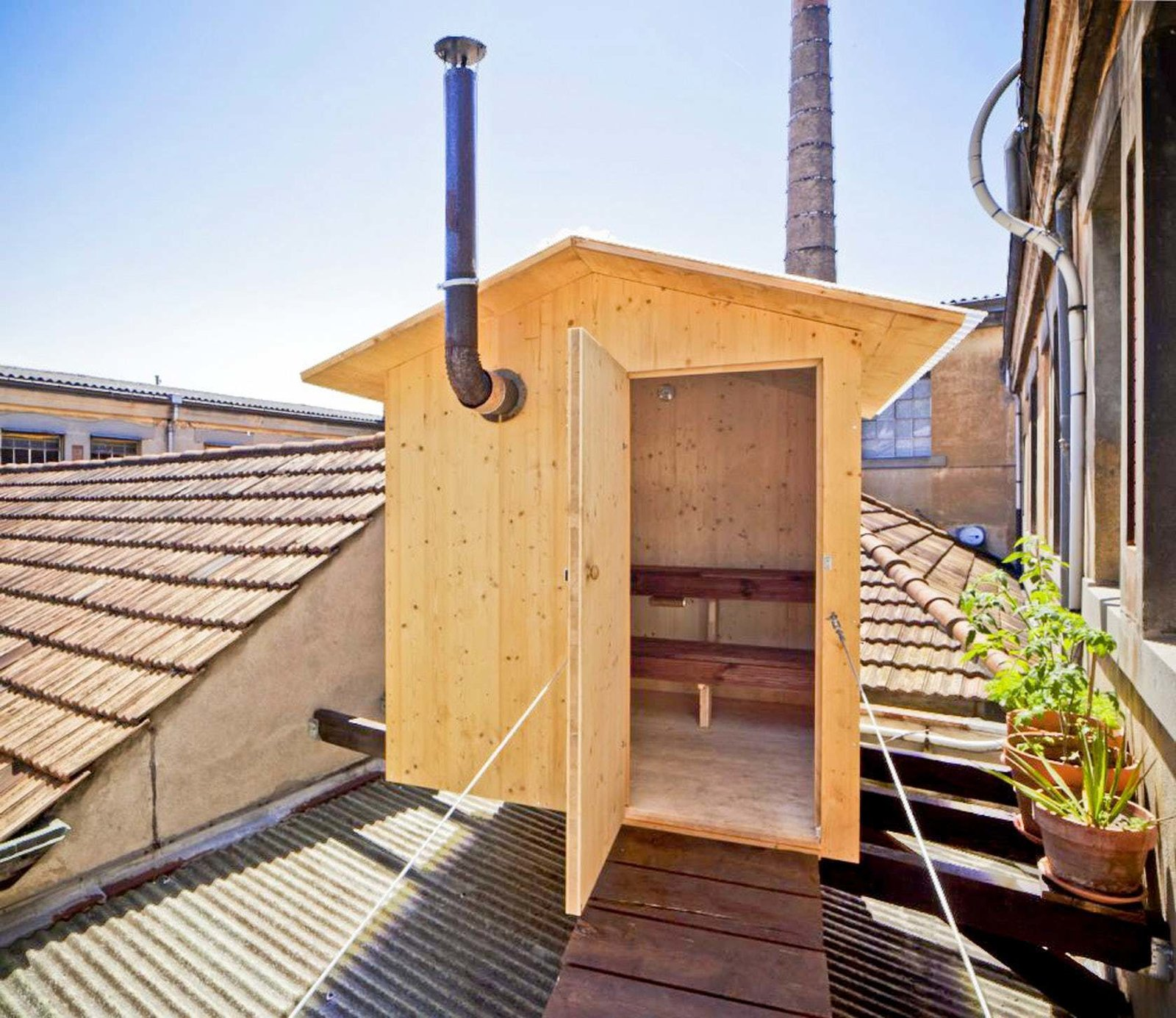 Shed & Studio BERAU A design this sauna as a small levitating house, moored on the roof of an old factory to experiment dry heat sessions.   Photo 10 of 11 in Escape to One of These 10 Otherworldly Outdoor Saunas