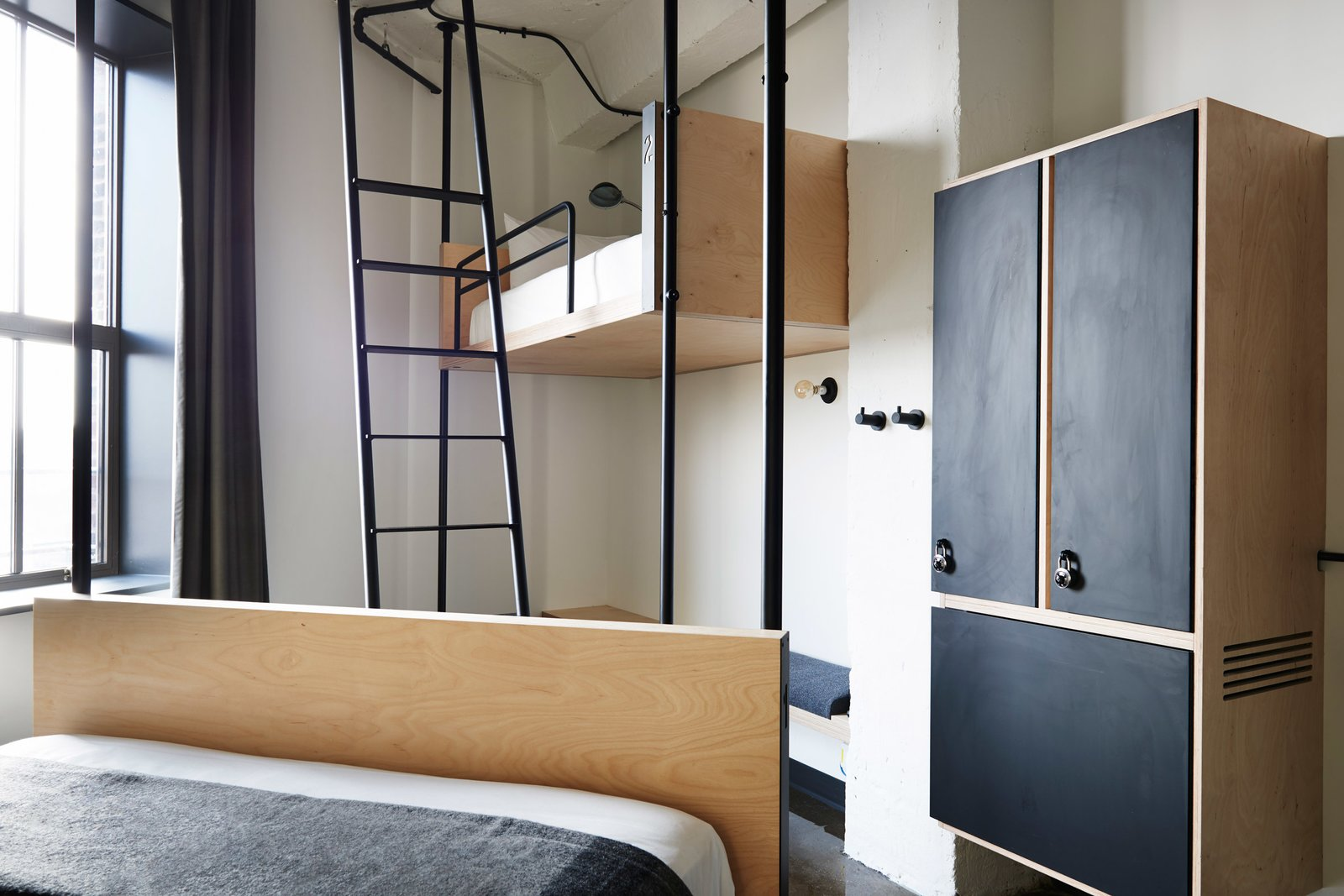 Bedroom, Bunks, Bed, Wall Lighting, and Wardrobe Photography is by Olivier Blouin.  Photo 4 of 7 in 6 Well-Designed Hostels For the Minimalist Traveler from Well-Designed Hostels