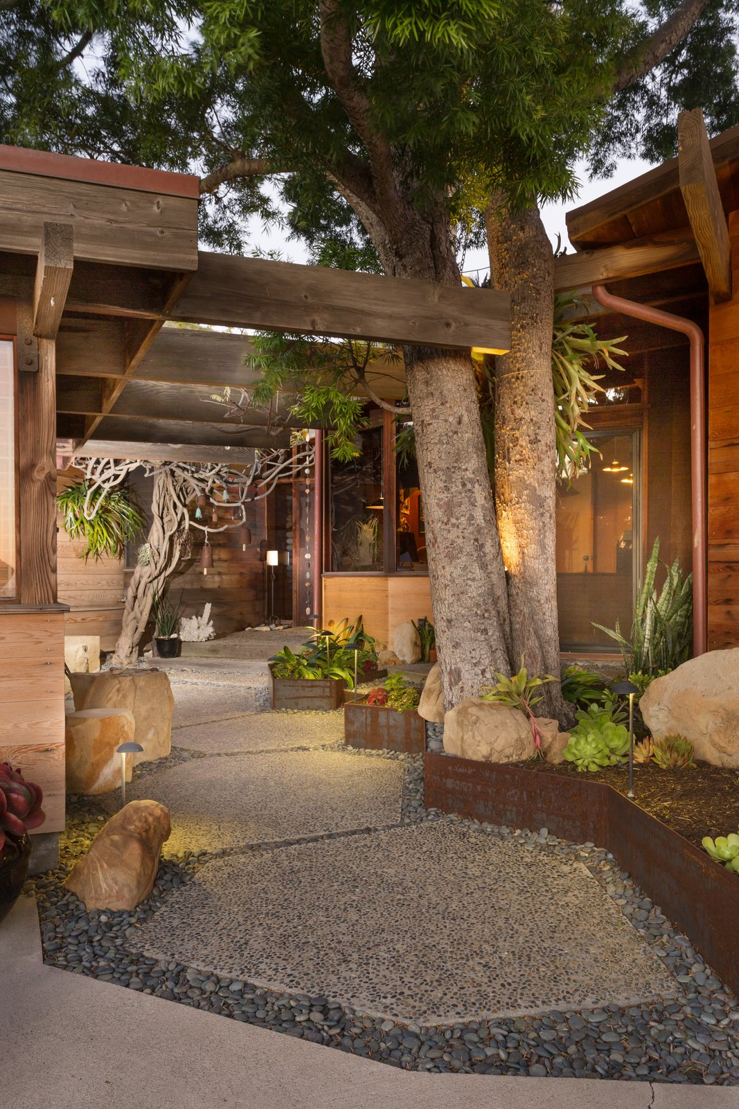 Outdoor, Walkways, Hardscapes, Garden, Stone Patio, Porch, Deck, and Flowers  Photo 8 of 13 in A 1974 Masterpiece Is Put on the Market by a Family Friend of the Late Julius Shulman
