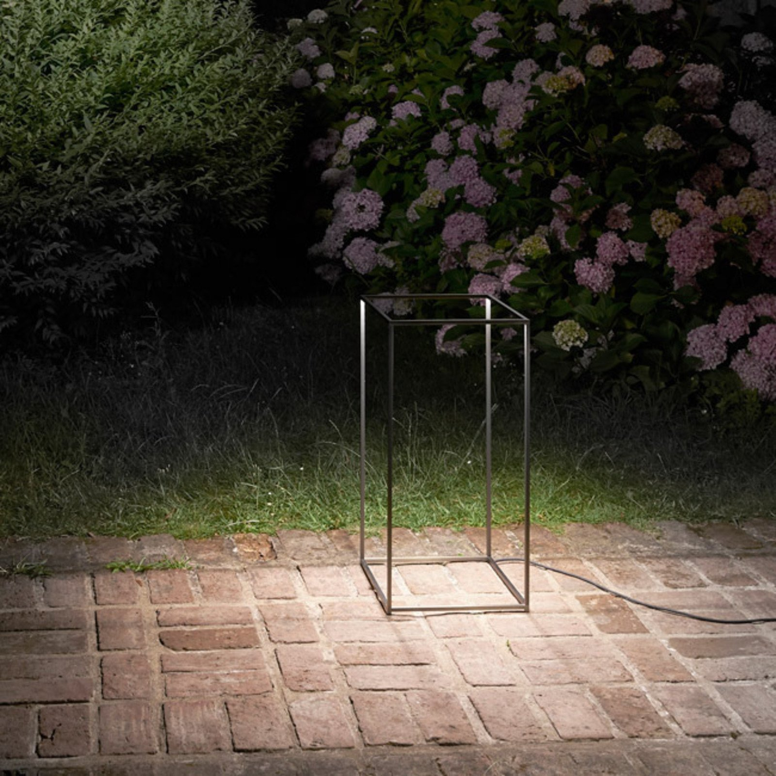 Mimicking a 3D sketch of a rectangular prism, Guido Bianchi and Nicoletta Rossi designed this bold light for FLOS.  Photo 8 of 10 in 9 Ways to Create the Perfect Outdoor Lighting