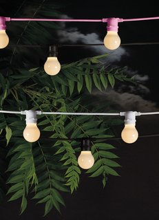 Though these rubber outdoor string lights by Seletti are no longer available, they may provide some inspiration for figuring out a similar effect in your outdoor space.