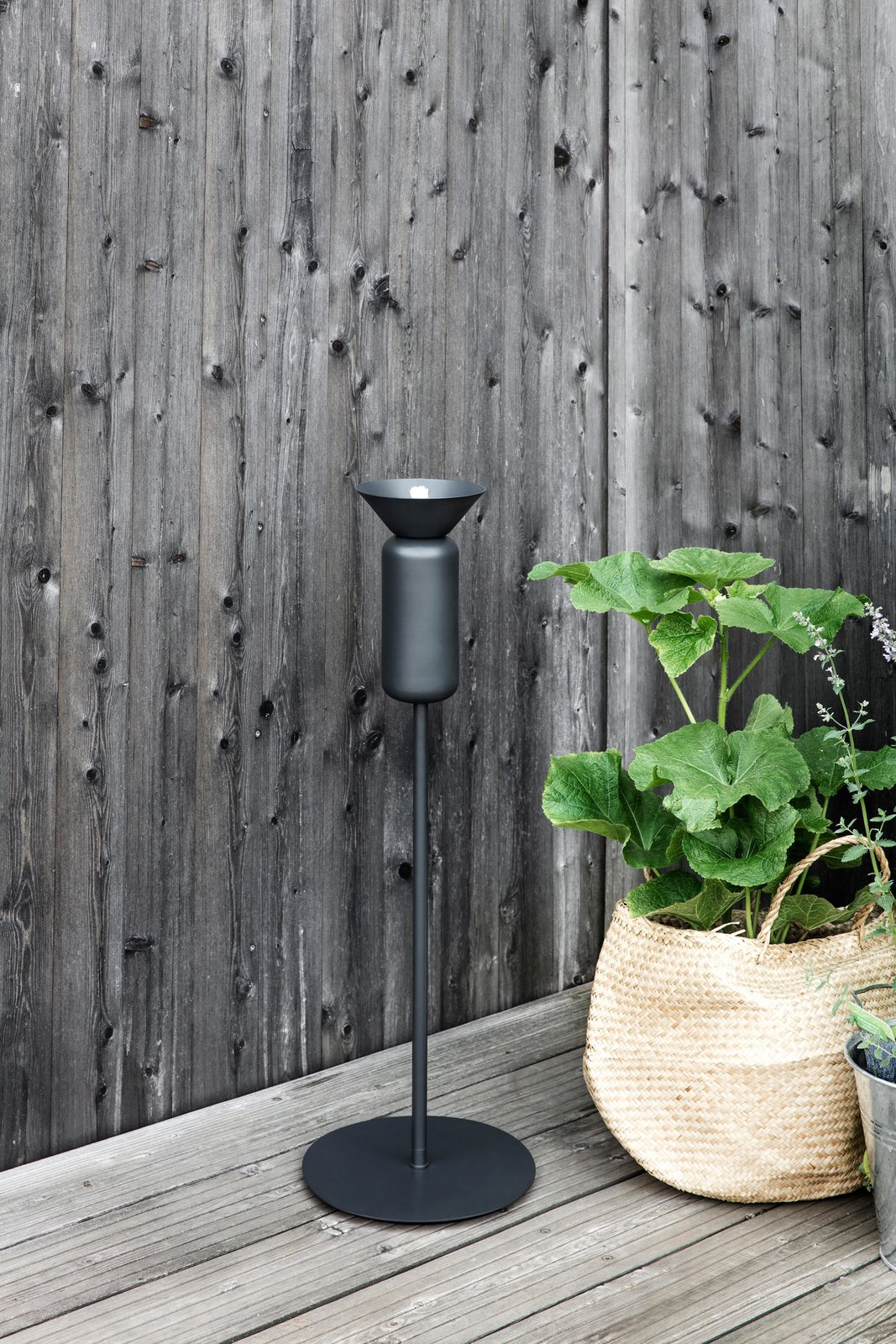 Inspired by a field of tall poppies, these outdoor oil lamps by Northern Lighting were crafted in a shape that captures the flowers' elegant stems and the crowns.  Photo 9 of 10 in 9 Ways to Create the Perfect Outdoor Lighting