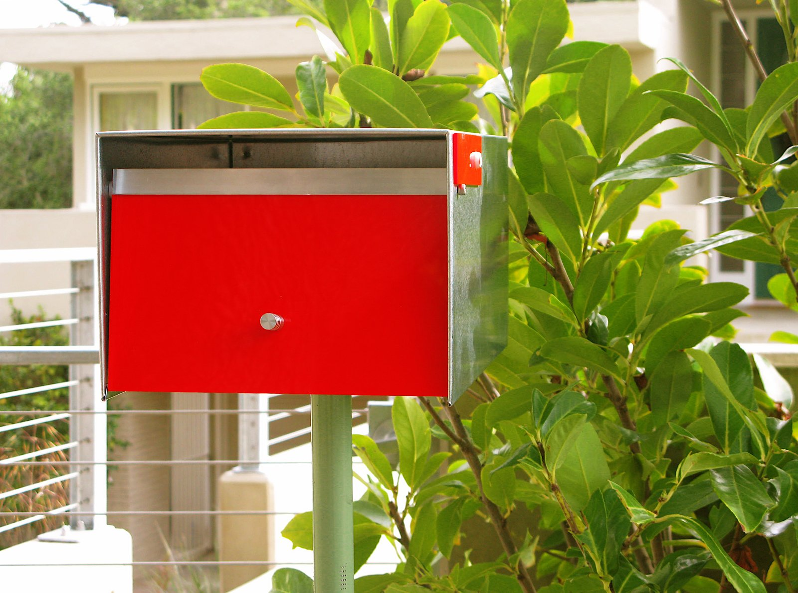 Outdoor, Front Yard, and Shrubs The Neutra Box is handmade from locally sourced, upcycled sheet metal remnants, reclaimed mostly from outfits in Richmond, California. The box retails for $199.00 and is available in red and black.  Photo 5 of 6 in 8 Best Modern Mailboxes to Buy