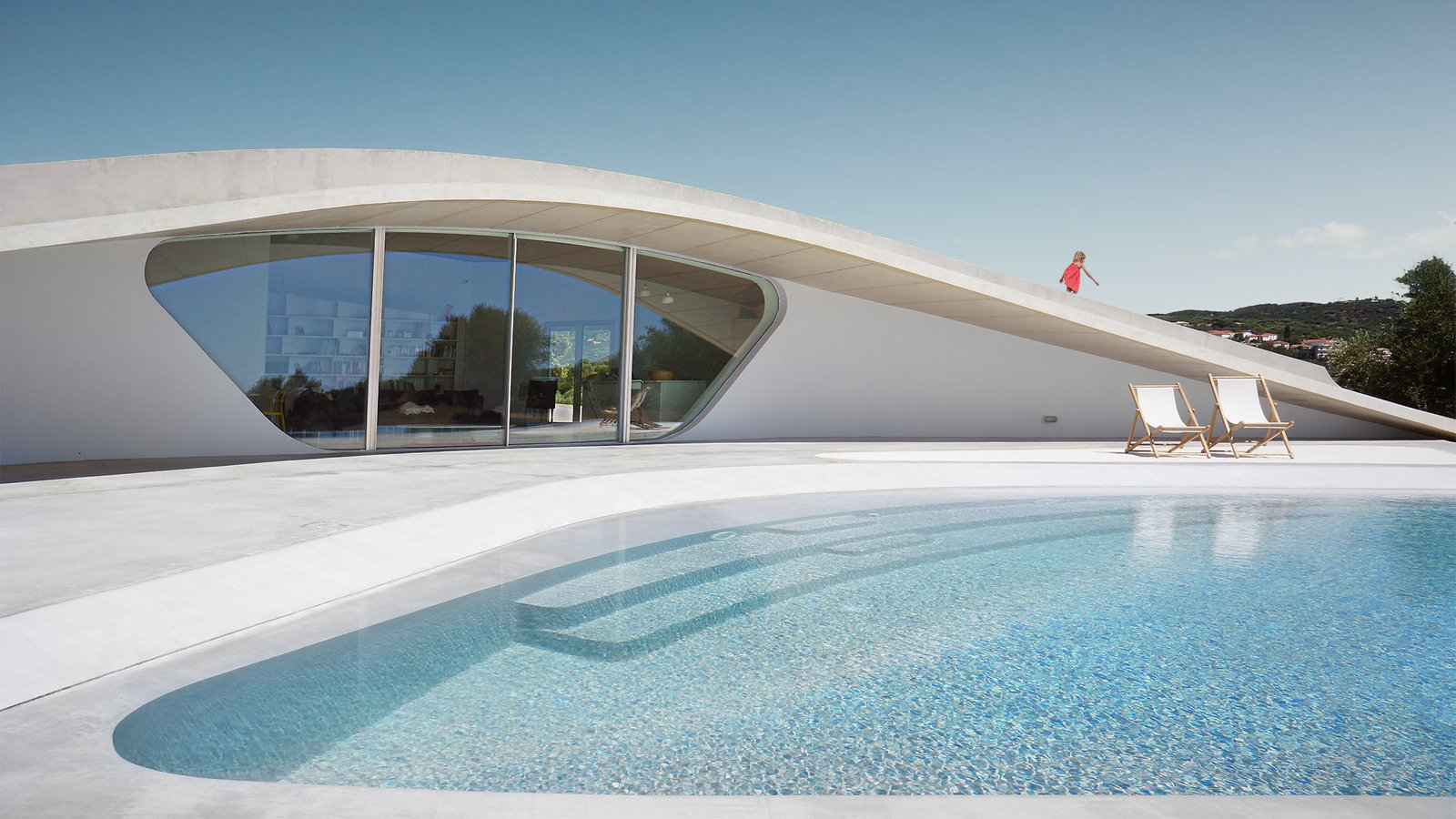 Large, Back Yard, Concrete, Large, Exterior, Stucco, and House  Best Exterior Back Yard Concrete Photos from This Y-Shaped Greek Villa Looks Like a Flying Saucer That's Embedded Into the Hills