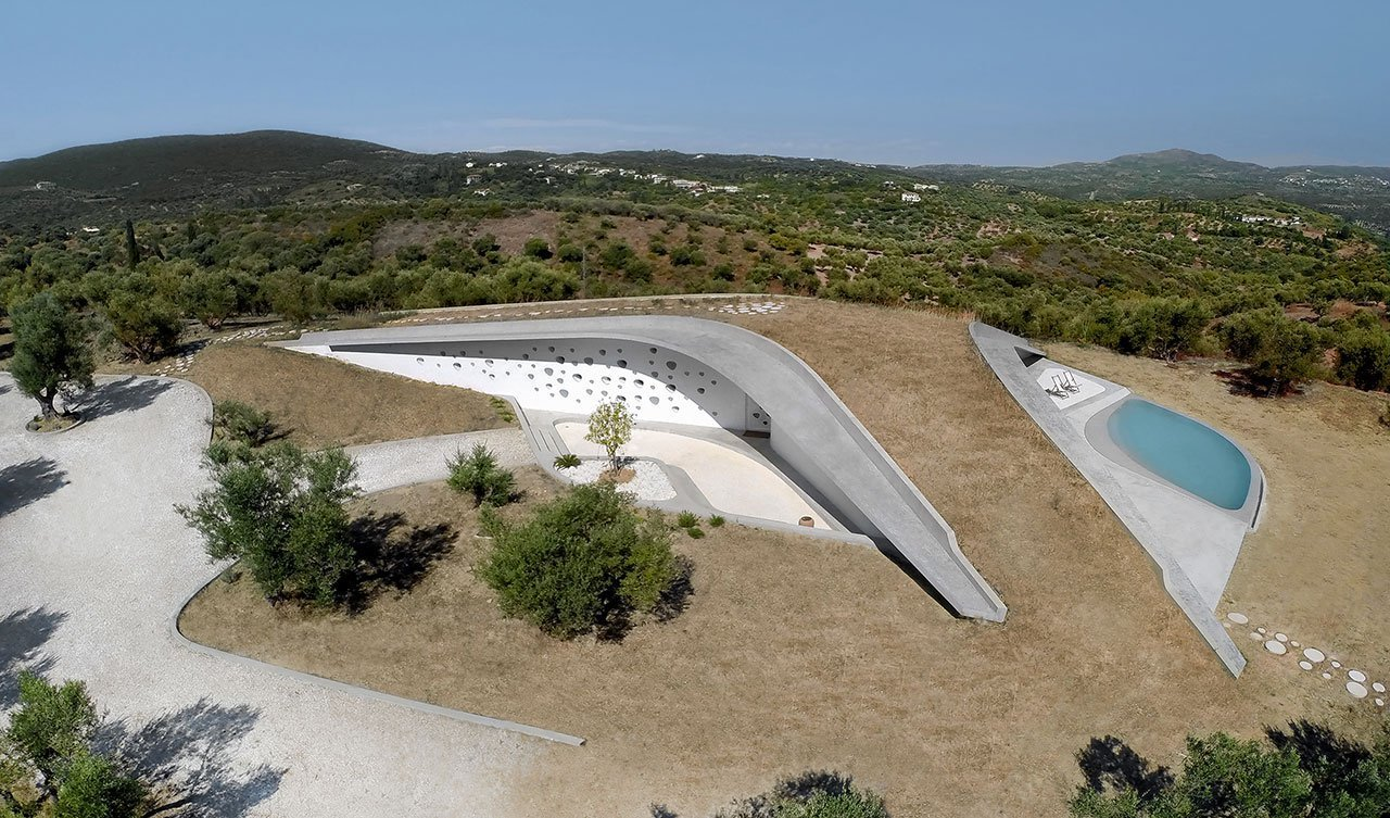 Outdoor, Rooftop, Grass, Trees, Shrubs, Hardscapes, and Large Pools, Tubs, Shower  Photo 2 of 9 in This Y-Shaped Greek Villa Looks Like a Flying Saucer That's Embedded Into the Hills