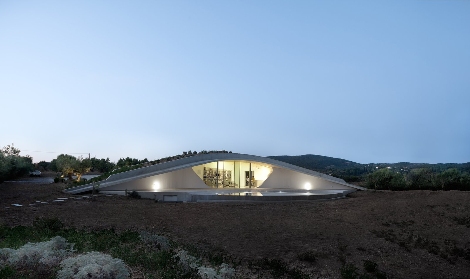 Exterior and House Building Type  Photo 9 of 9 in This Y-Shaped Greek Villa Looks Like a Flying Saucer That's Embedded Into the Hills
