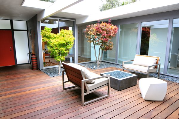 Outdoor, Trees, Wood Patio, Porch, Deck, Small Patio, Porch, Deck, and Hardscapes  Photo 8 of 11 in An Interior Designer Launches Her Career by Renovating Her Family's Midcentury Eichler