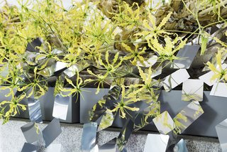 At a Japanese Flower Art School, Nendo Drapes an Ivy of Mirrors Over a Stone Garden by Isamu Noguchi - Photo 6 of 9 -