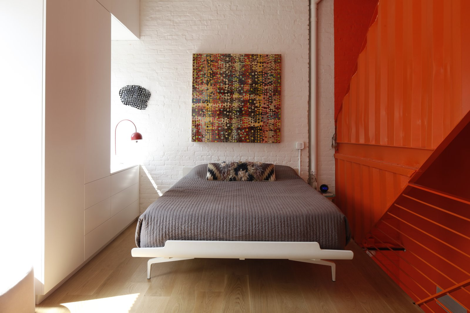 Bedroom, Bed, Light Hardwood Floor, and Table Lighting  Photo 9 of 12 in A Brooklyn Carriage House Is Revamped With a Penthouse Made From Shipping Containers