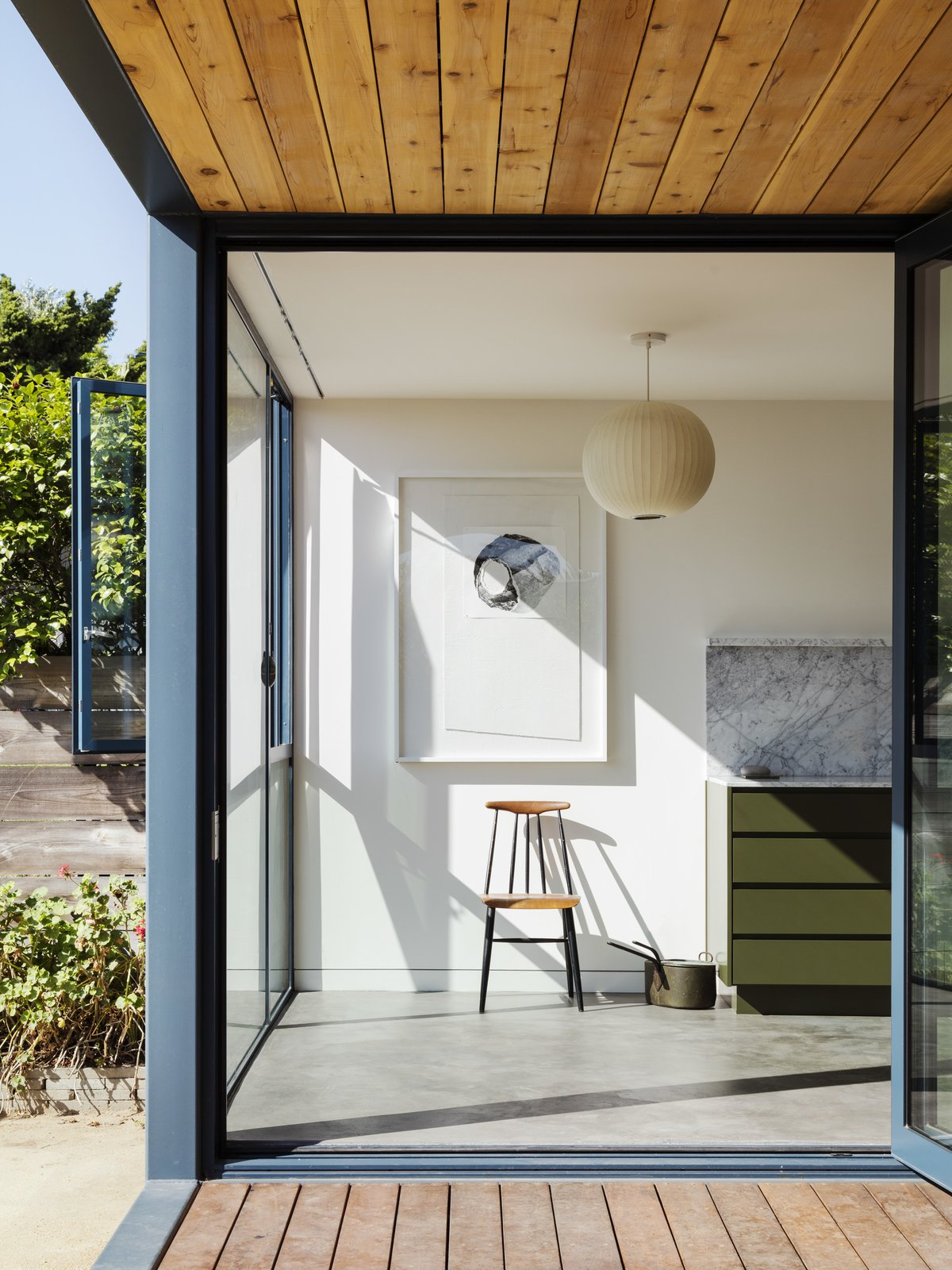 Windows and Metal  Photo 12 of 14 in Grids and Colors Inspire the Renovation of a Graphic Designer's Pink L.A. Bungalow