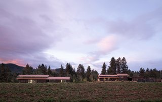 """""""It's here that the clients and their friends, family, and fellow artists can experience the beautiful agricultural and natural landscape, with Mount Adams in the distance and the White Salmon river flowing through the property,"""" say the architects."""