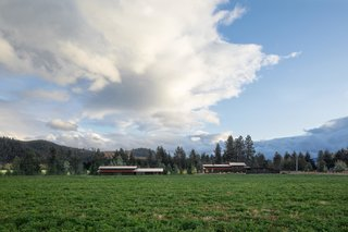 Located on 18 acres of an agricultural property in Trout Lake, Washington, the artist retreat is set just steps from the white Salmon River.