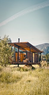 """Olson Kundig's six Rolling Huts boast steel-clad exteriors matched by unassuming interiors. The structures are designed to """"take second place to nature."""""""
