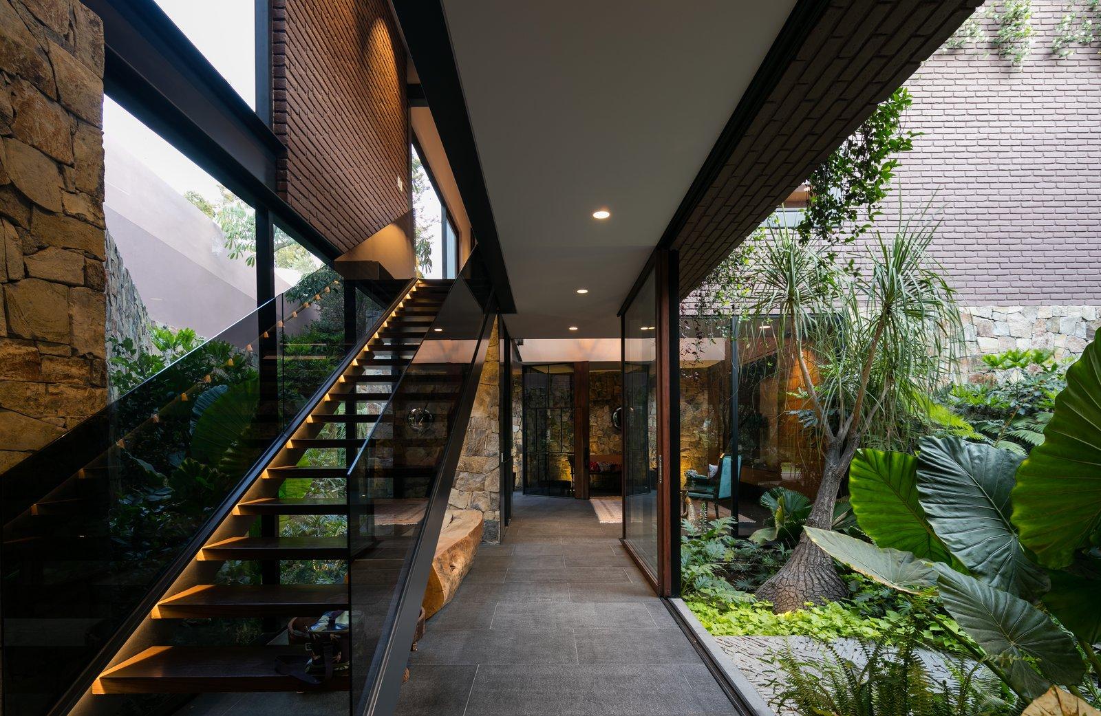 Staircase, Metal Tread, Wood Tread, Glass Railing, and Metal Railing  Casa OM1