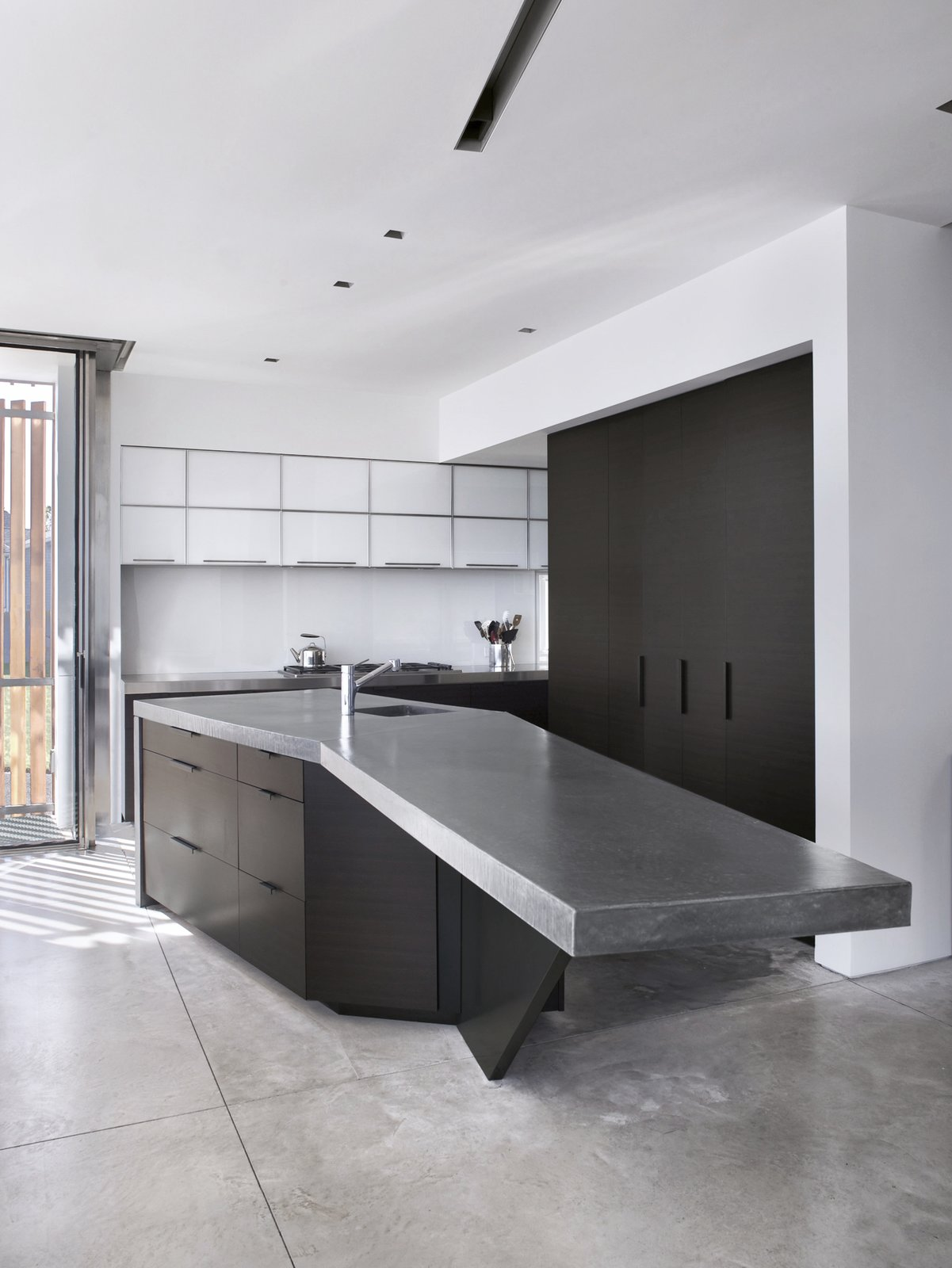 Kitchen, Range, Refrigerator, White Cabinet, Ceiling Lighting, and Undermount Sink  Spiral House by Joeb Moore & Partners