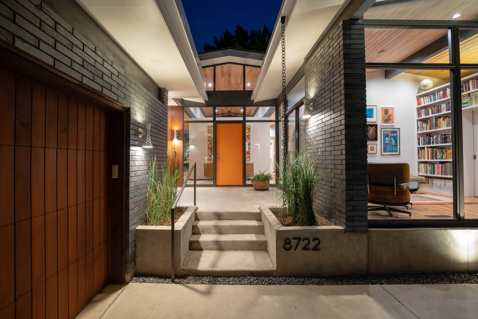 Exterior, Mid-Century Building Type, House Building Type, Flat RoofLine, Wood Siding Material, Metal Roof Material, Gable RoofLine, and Brick Siding Material  House  //  TW by M Gooden Design