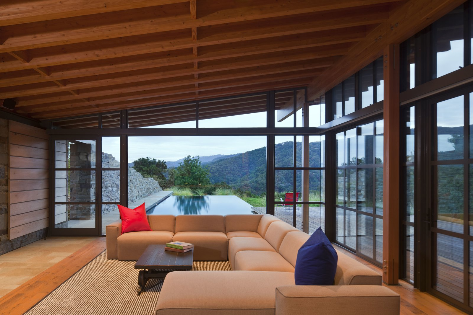 Living Room, Sectional, Coffee Tables, Light Hardwood Floor, and Rug Floor  Halls Ridge Knoll by Bohlin Cywinski Jackson