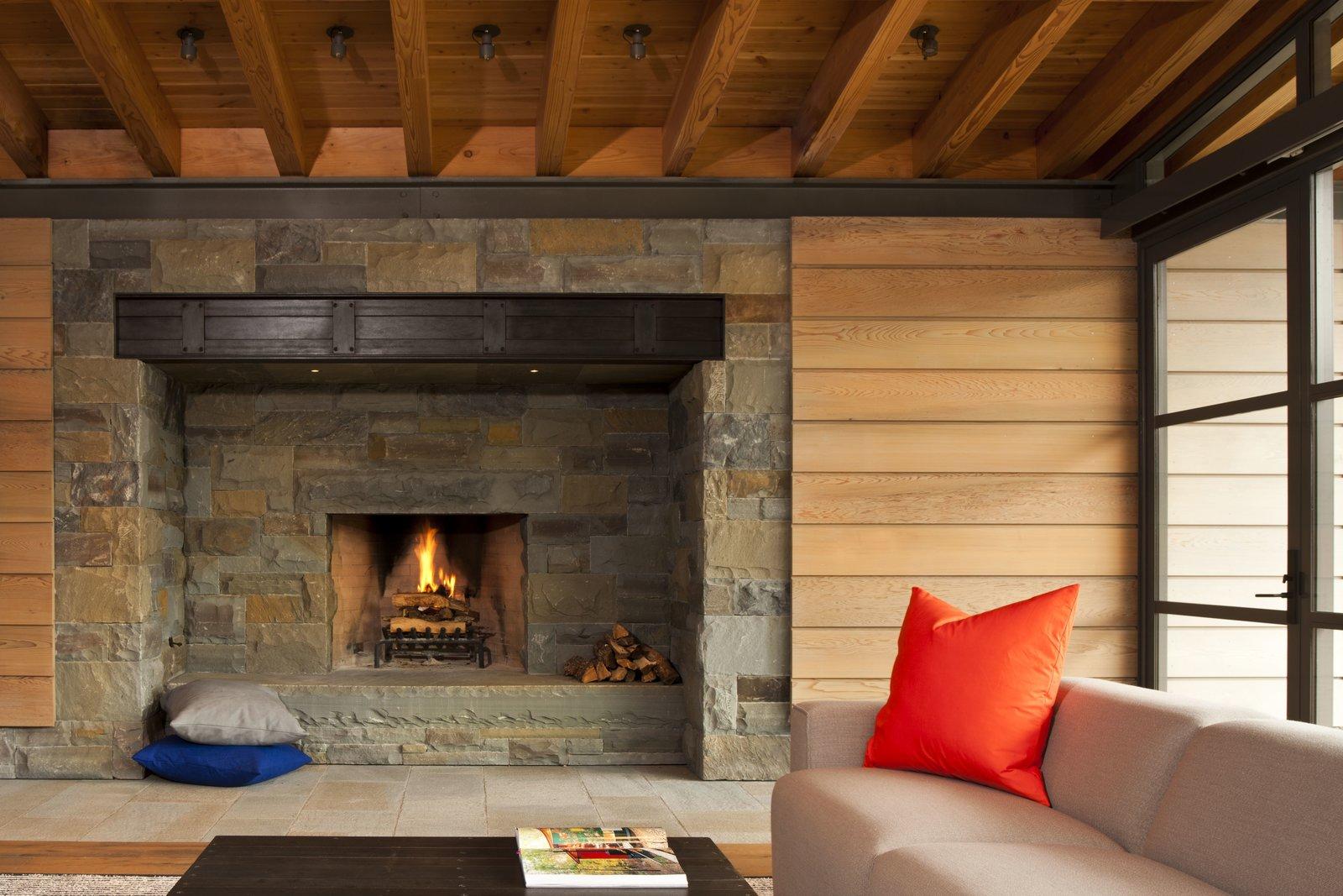 Living Room, Wood Burning Fireplace, Coffee Tables, Light Hardwood Floor, and Sectional  Halls Ridge Knoll by Bohlin Cywinski Jackson