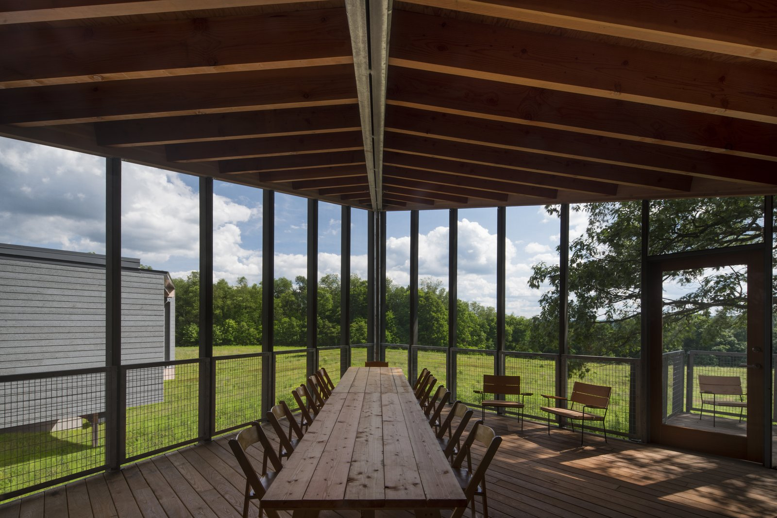 Dining Room, Chair, Medium Hardwood Floor, and Table  High Meadow at Fallingwater by Bohlin Cywinski Jackson