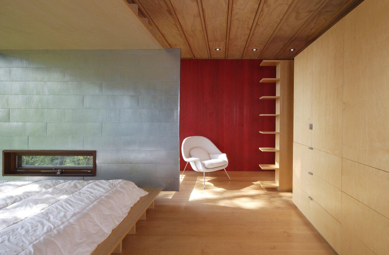 Bedroom, Light Hardwood Floor, Storage, Bed, and Chair  Edge House by Bohlin Cywinski Jackson