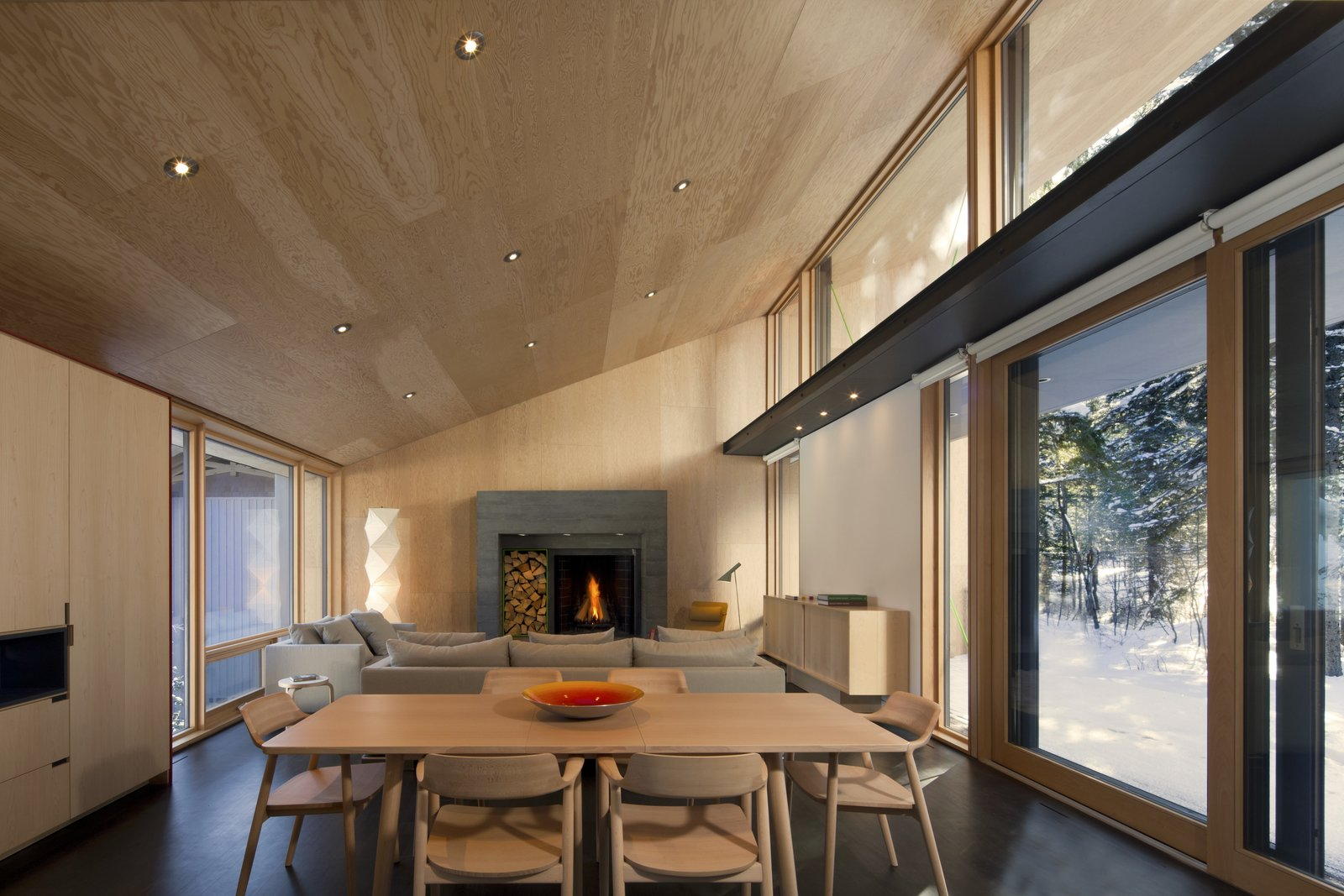 Wood Burning Fireplace, Table, Chair, Living Room, and Recessed Lighting  Cabin ideas from Kicking Horse Residence