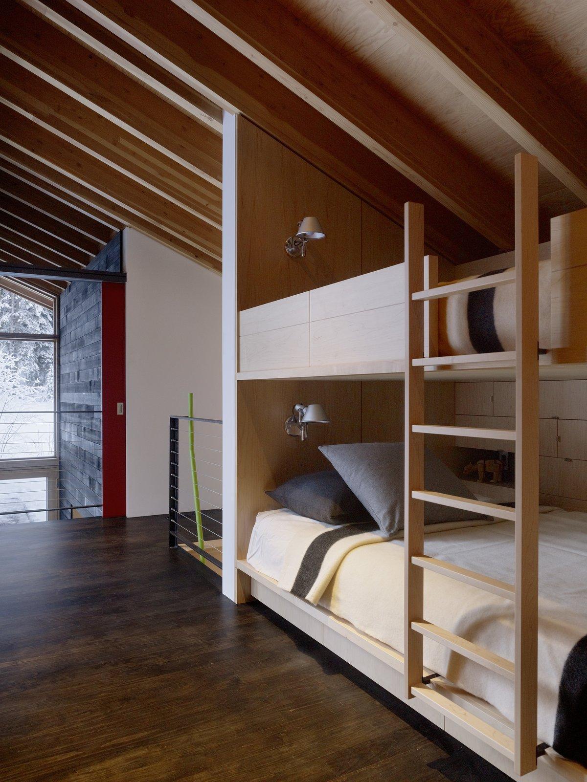 Bedroom, Bunks, Wall Lighting, and Dark Hardwood Floor  Kicking Horse Residence by Bohlin Cywinski Jackson