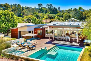 10 Modernist Beach Home Rentals to  Escape to This Summer - Photo 3 of 10 - Designed by Tim Golba, this 3,400-square-foot home is walking distance to the La Jolla beaches. The home was constructed as a modernist oasis, with an emphasis on reflecting the peace and tranquility of the La Jolla landscape. The home features disappearing glass walls and a spacious, minimalist interior aesthetic that unites concrete and glass under soaring ceilings and extended outdoor living areas.