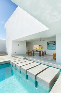 10 Modernist Beach Home Rentals to  Escape to This Summer - Photo 5 of 10 - Designed by Campos Leckie to invoke a pure, dream-like quality, this minimalist retreat is situated on a hill above Zippers Beach overlooking the Sea of Cortez. The bold geometric angles, stripped down interior, and whitewashed walls allow for maximum light and shadow play throughout the day. The home features a Zen garden, central pool, and a rooftop patio with sweeping views of the ocean and mountains.