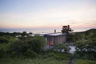 "10 Modernist Beach Home Rentals to  Escape to This Summer - Photo 8 of 10 - Originally designed by Jack Hall in the 1960s for Robert Hatch, an editor of The Nation and his wife, the ""experimental cottage"" is actually a series of separate cubes that are connected to a large central living area via outdoor decks—constructed in such a way that the cottage looks as though it's floating slightly above ground. The home is designed with sweeping views of the Outer Cape and is near some of the highest-rated beaches in the continental U.S."