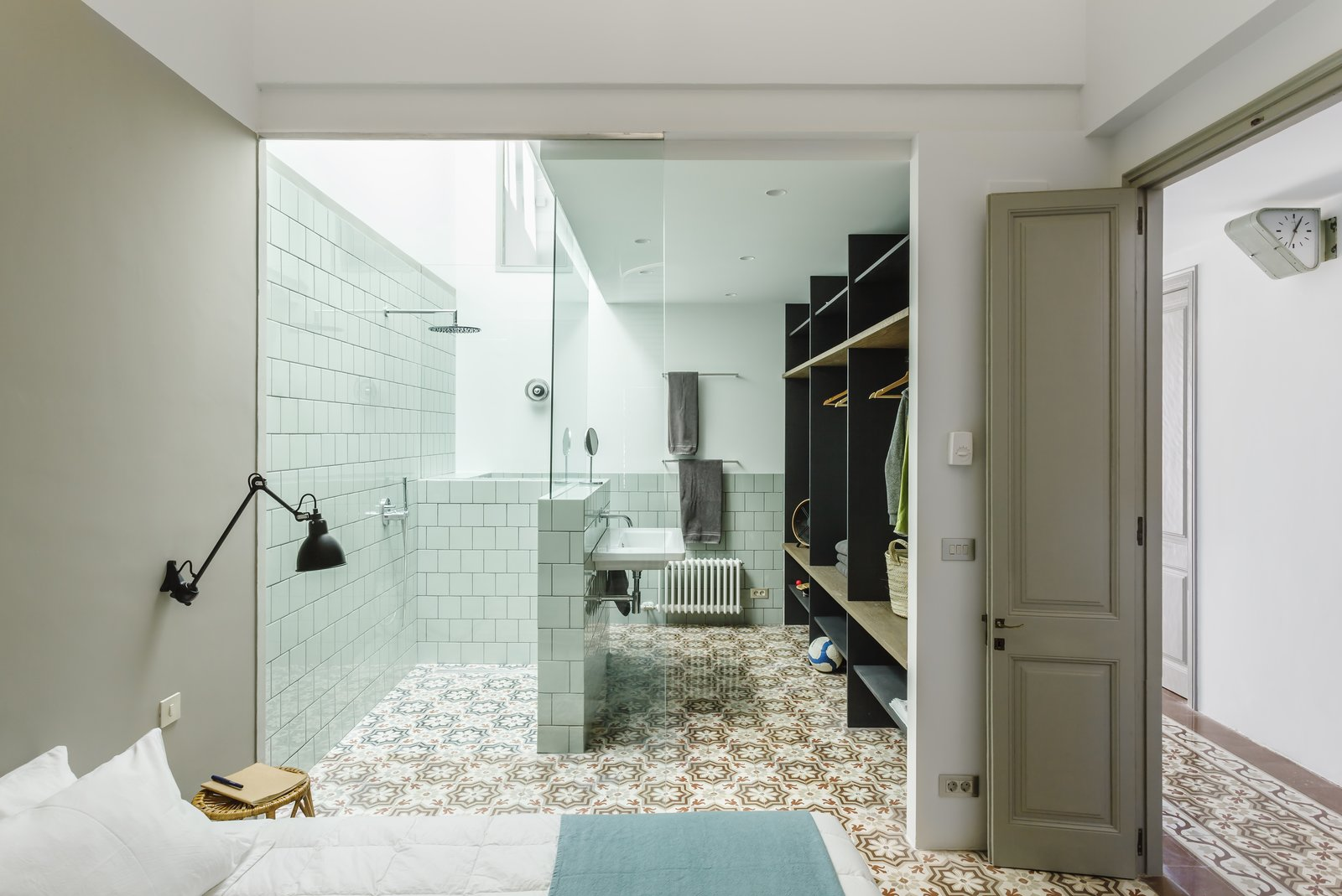 Bath, Ceramic Tile, Wall Mount, Open, and Porcelain Tile  Best Bath Open Porcelain Tile Photos from A Careful Renovation Brings New Life to a Family's Heritage Home on the Spanish Coast