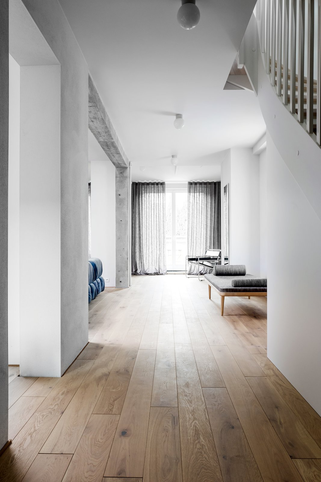 Hallway and Light Hardwood Floor  Photo 3 of 12 in A Family's Loft in Poland Gets a Minimalist Renovation That's Both Elegant and Functional