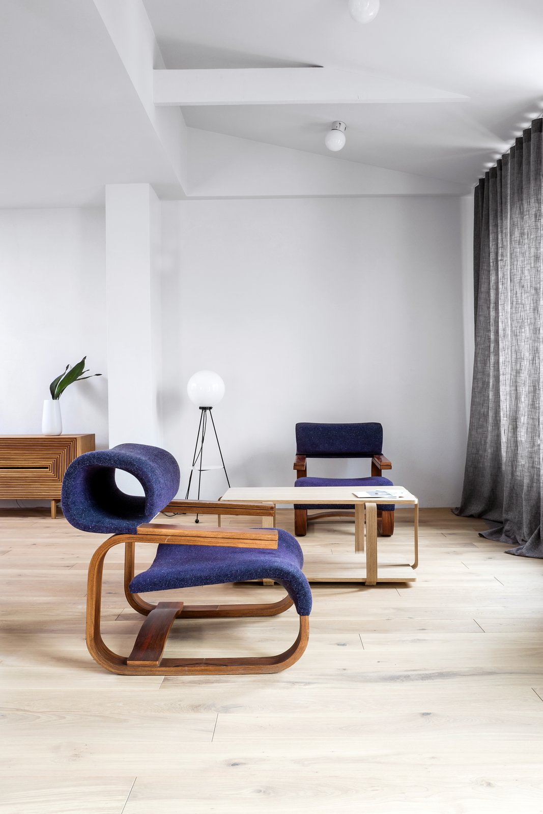 Living Room, Coffee Tables, and Chair Armchair designed by Jan Bocan (1972)  Photo 2 of 12 in A Family's Loft in Poland Gets a Minimalist Renovation That's Both Elegant and Functional