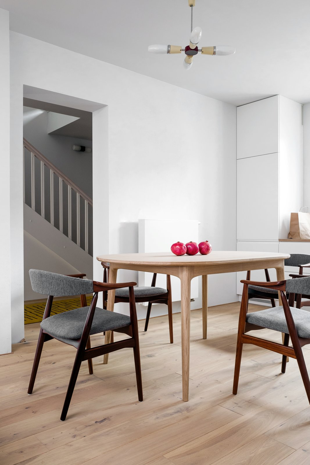 Dining Room, Table, Chair, and Pendant Lighting  Photo 6 of 12 in A Family's Loft in Poland Gets a Minimalist Renovation That's Both Elegant and Functional