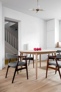 A Family's Loft in Poland Gets a Minimalist Renovation That's Both Elegant and Functional - Photo 6 of 12 -
