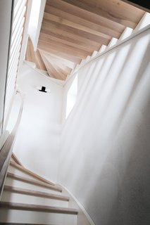 A Family's Loft in Poland Gets a Minimalist Renovation That's Both Elegant and Functional - Photo 4 of 12 -