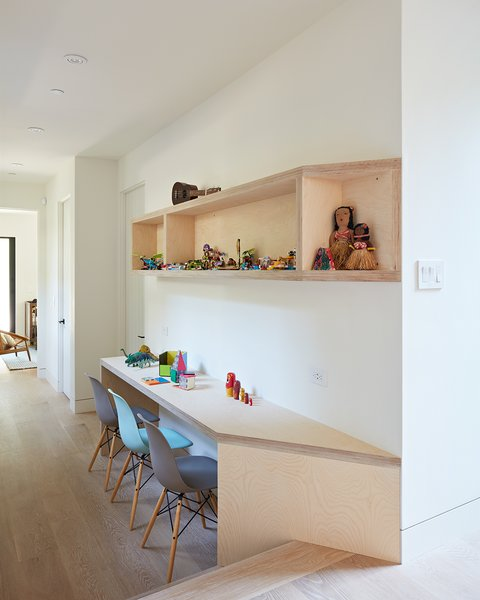 The hallway between the kids' bedrooms now serves as a shared desk space for building legos, doing homework, projects. It was a great way to utilize a wide hallway and make it more functional.