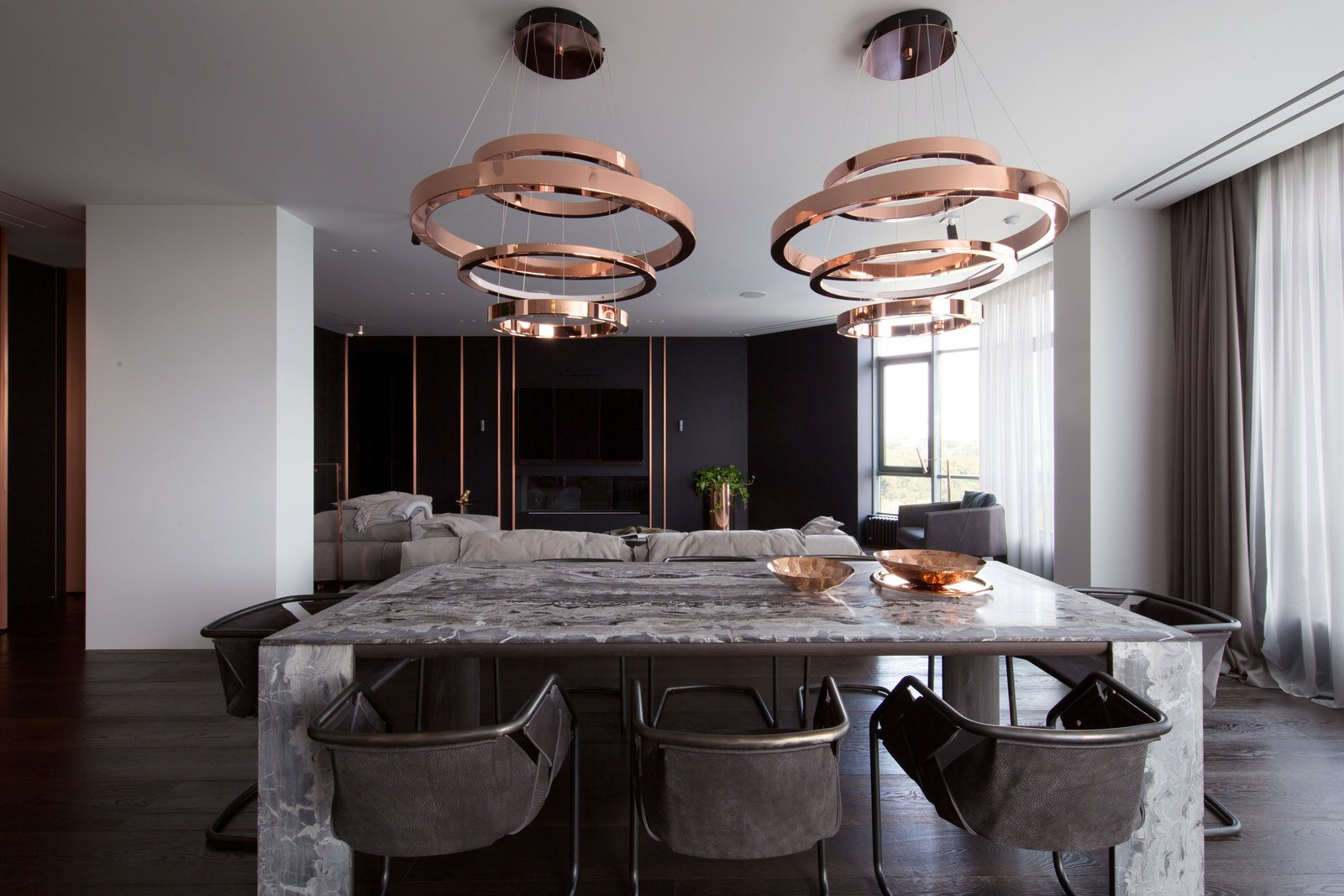 Dining Room, Pendant Lighting, Chair, Table, and Dark Hardwood Floor  Photo 1 of 13 in A Family's Kiev Apartment Is Filled With Copper, Marble, and a Sophisticated Palette