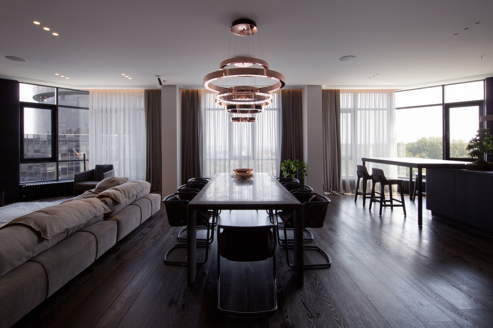 Dining Room, Pendant Lighting, Dark Hardwood Floor, Chair, and Table  Photo 2 of 13 in A Family's Kiev Apartment Is Filled With Copper, Marble, and a Sophisticated Palette