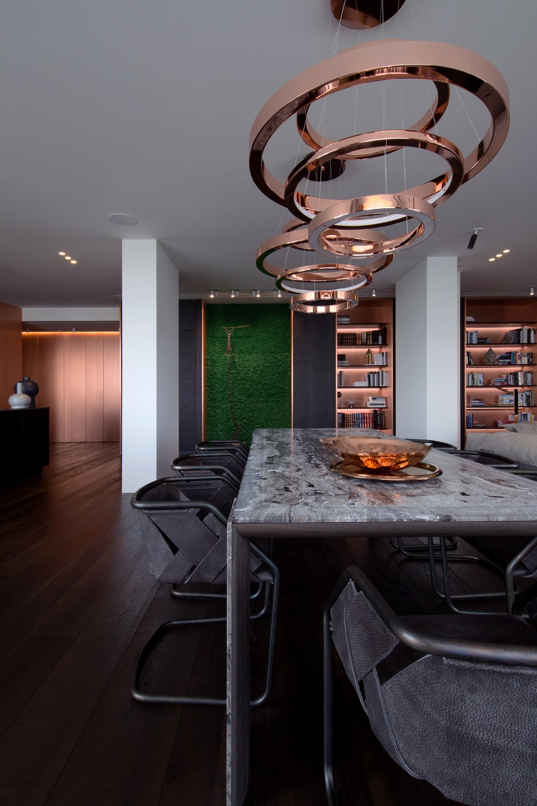 Dining Room, Pendant Lighting, Chair, Table, Shelves, and Dark Hardwood Floor  Photo 8 of 13 in A Family's Kiev Apartment Is Filled With Copper, Marble, and a Sophisticated Palette