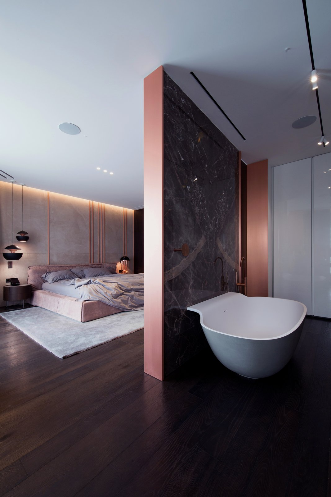 Bath Room, Freestanding Tub, Track Lighting, and Dark Hardwood Floor  Photo 9 of 13 in A Family's Kiev Apartment Is Filled With Copper, Marble, and a Sophisticated Palette
