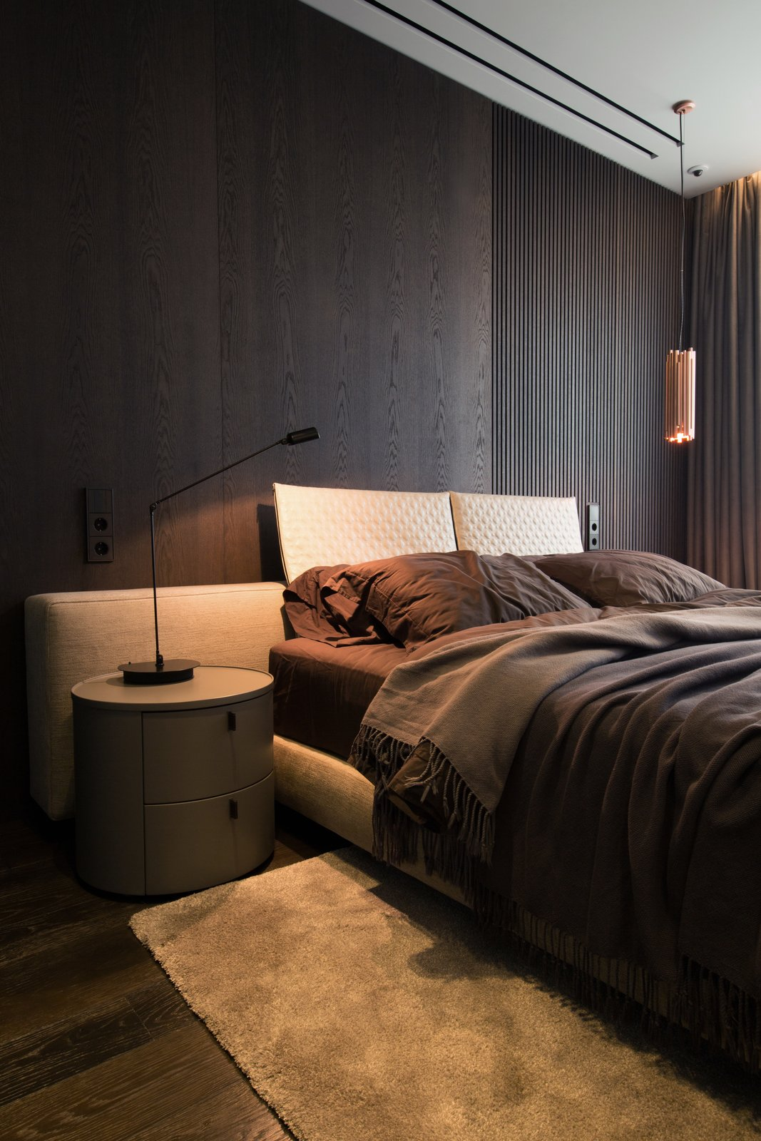 Bedroom, Bed, Night Stands, Lamps, Table Lighting, Dark Hardwood Floor, and Pendant Lighting  Photo 11 of 13 in A Family's Kiev Apartment Is Filled With Copper, Marble, and a Sophisticated Palette