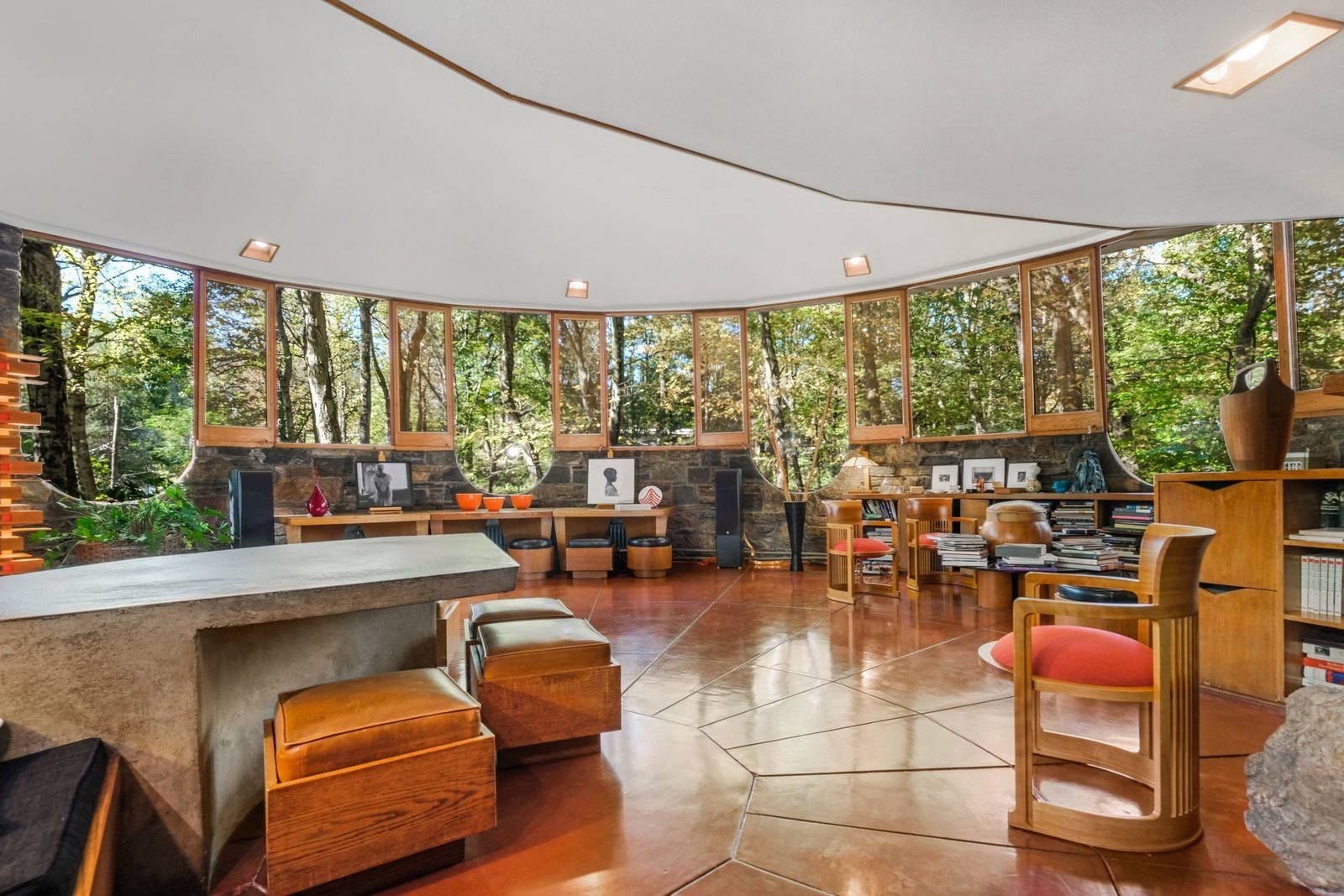Living Room, Ceiling Lighting, Recessed Lighting, Chair, Bookcase, Coffee Tables, Ottomans, and Bench  Photo 5 of 10 in A Usonian Masterpiece by Frank Lloyd Wright Is on the Market For $1.5M