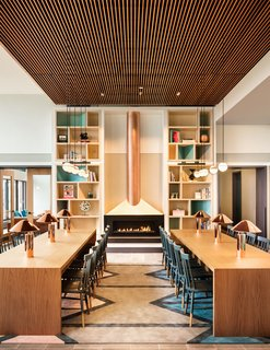 The Living Library is anchored by a copper fireplace.