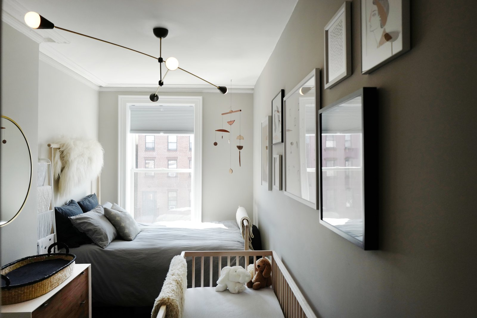 Kids Room, Bed, Bedroom Room Type, Dresser, Neutral Gender, Toddler Age, and Pre-Teen Age  Photo 13 of 16 in A Design Duo's 19th-Century Brooklyn Townhouse Is Filled With Art They Love